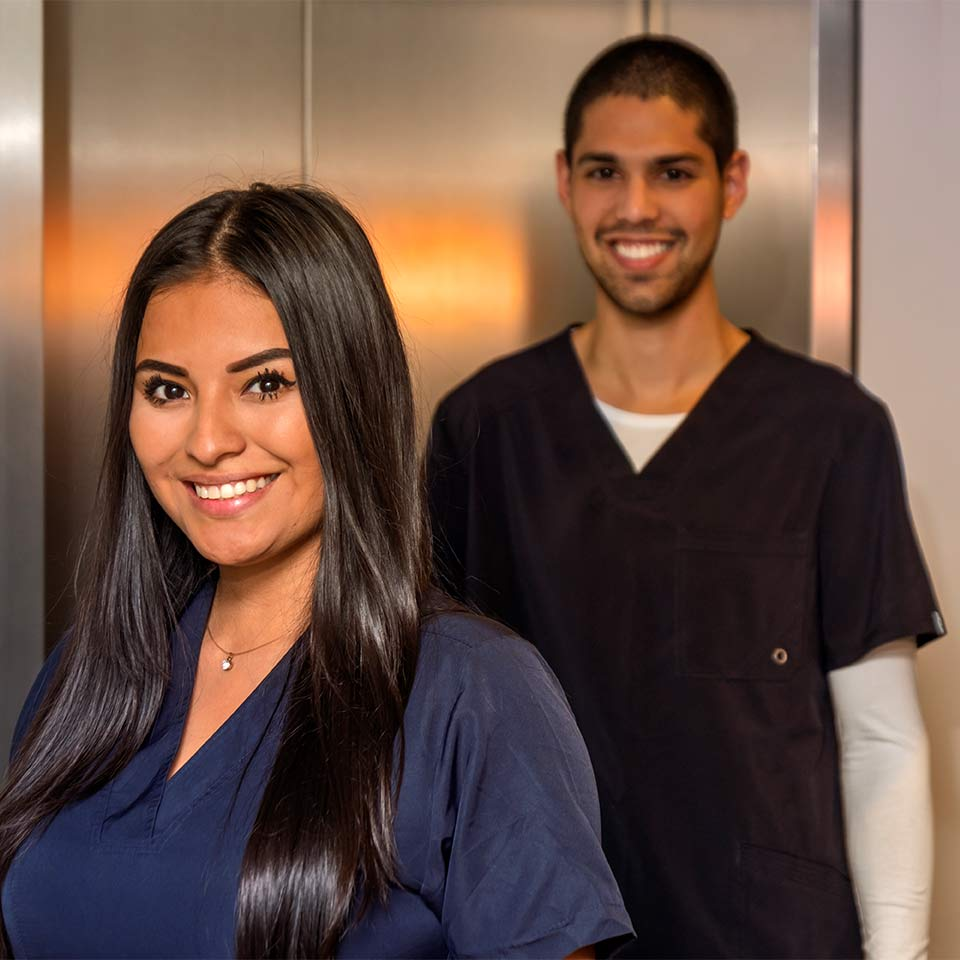 two smiling health care professionals
